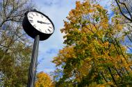 Autumn in the city park with clock.