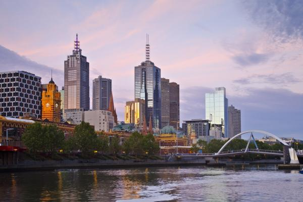 Melbourne skyline at sunset under a beautiful mauve sky.