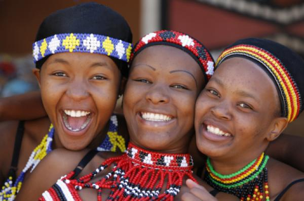 Three young Zulu women friends, dressed in traditional beaded Zulu