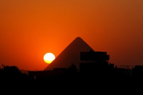 Sunset behind the pyramid of Cheops