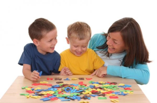 Children and mother playing with letters