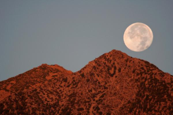 Full moon setting over Jobs Peak, Carson Valley, Nevada.