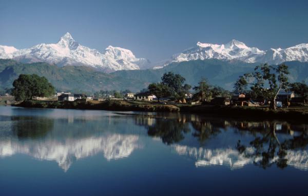 View of Machapuchare (Fishtail mountain) and the Himalaya from Damside at Pokhara, Nepal
