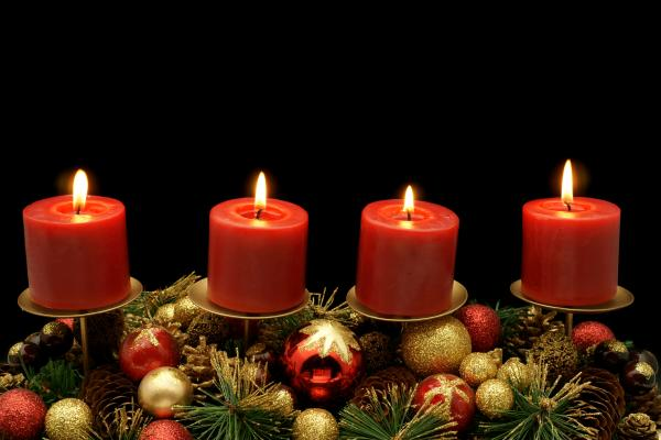 Four advent candles with decoration.