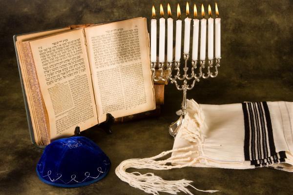 Jewish prayer shawl, cap and nine candle menorah
