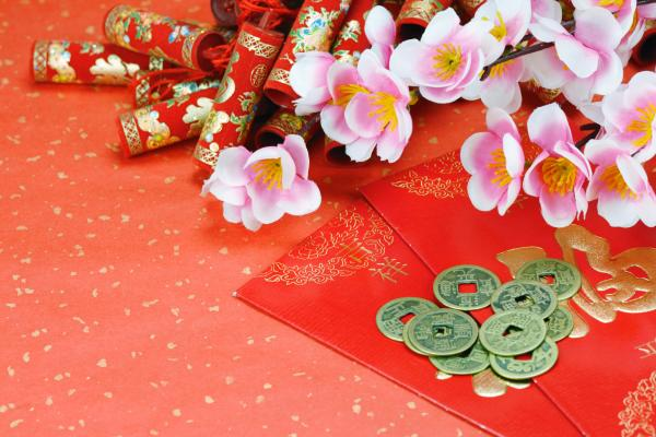 Studio shot of red envelope with money and chinese lunar new year decoration