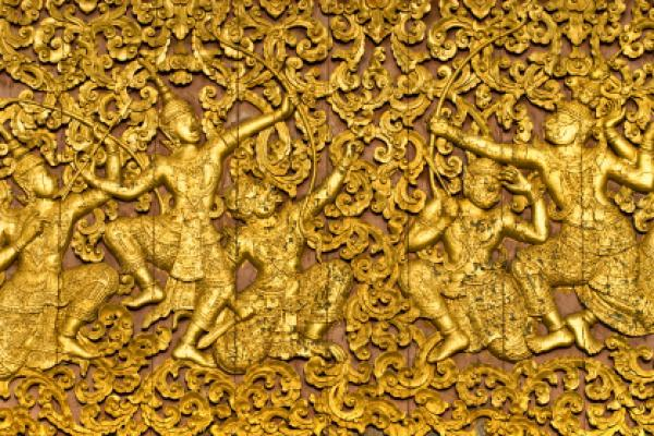 The ramayana epic carved on a wood door inside a temple.