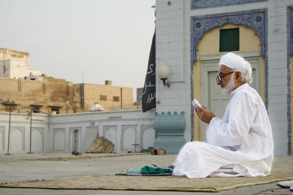 Man Reading Quran