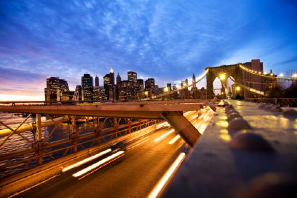 New York City Skyline Manhattan view from the Brooklyn Bridge motion blur from the cars in the rush hour