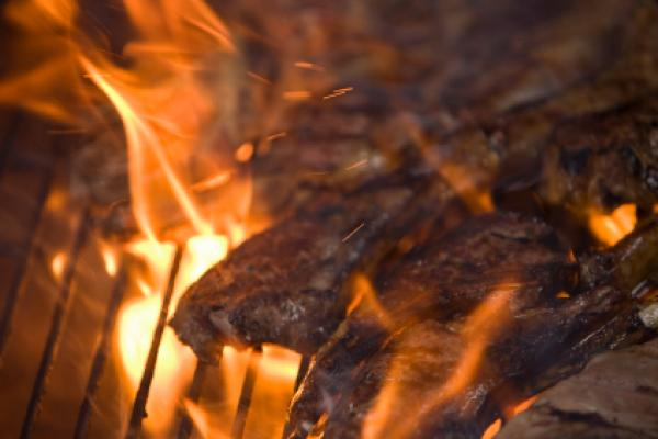 Close detail of lamb chops flame grilling