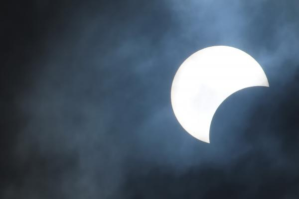 partial solar eclipse looks like the Moon has taken a bite of the ...