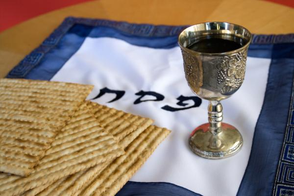 Matzo and a wine in a Kiddush cup