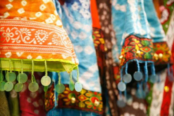 Textiles from India in a marketplace.