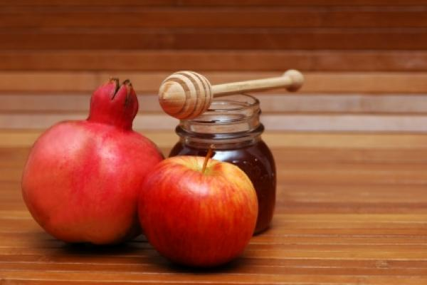 Pomegranate, apple and honey are symbols of Rosh Hashana.