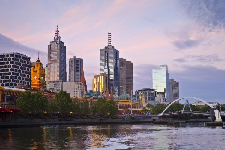 Melbourne skyline at sunset under a beautiful mauve sky.