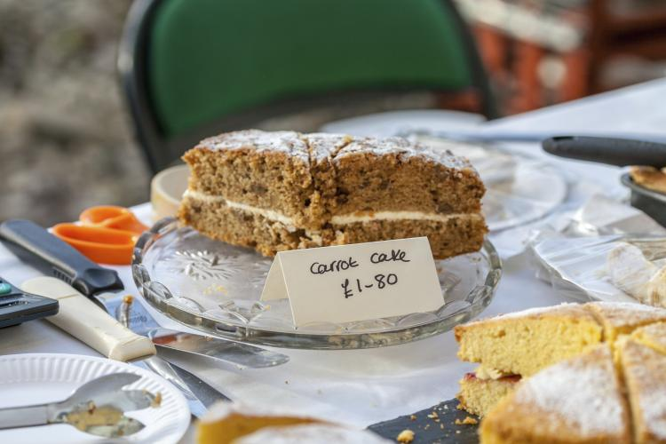 Home made carrot cake for sale at food market.