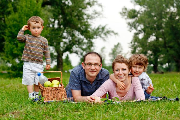 portrait of happy family having a picnic