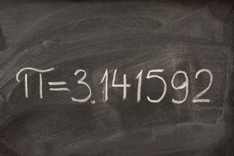 The number pi on a blackboard.