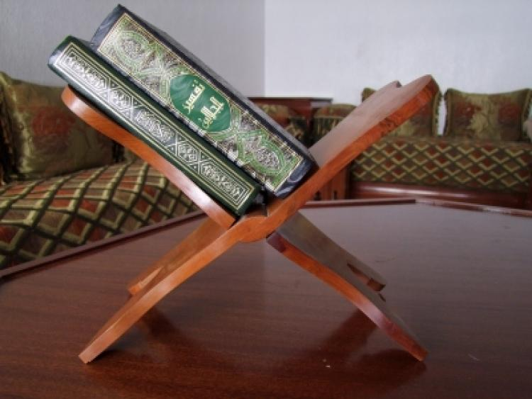 Traditional wooden holy bookstand whit the Koran