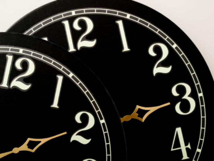 Two clock faces showing hours to adjust your clocks for Daylight Saving time.