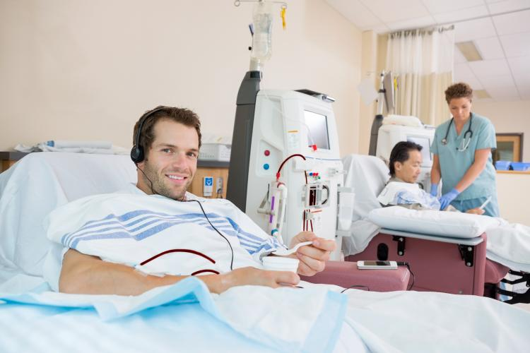 Young man undergoing dialysis.