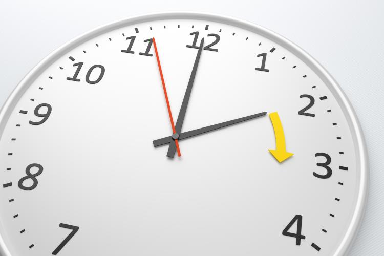 An image of a white clock for DST, Spring Forward.