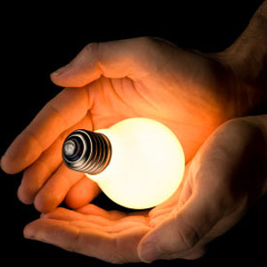 Illustration photo of light bulb in two hands