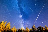 Shooting stars on a dark night sky.