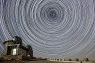 Star trails over an observatory.