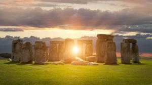 The Sun shining through the Stonehenge ancient monument.
