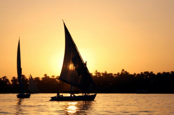 Sailing a felucca, a type of sailing boat, on the Nile River in Luxor, Egypt.