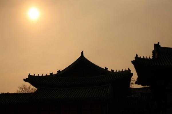 Sun above Changgyeong Palace in Seoul, South Korea
