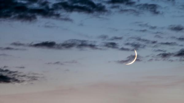 A Waxing Crescent Moon in the evening.