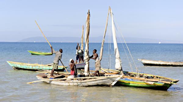 Haitian fishermen in their boats preparing for a day of fishing off the shore near Saintard, Haiti.