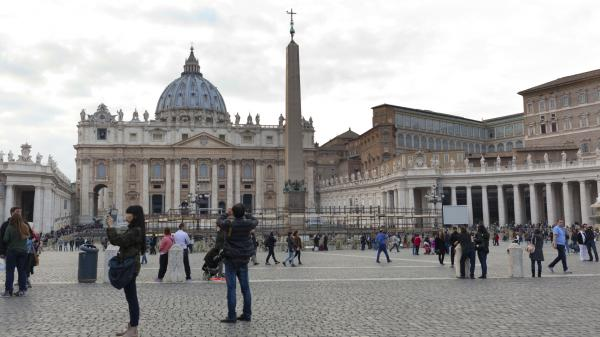 Tourists visiting the Papal Basilica of St. Peter in the Vatican City Rome, Italy - November 14, 2015