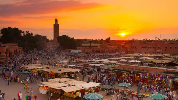 Sunset at Jamaa el Fna market in Marrakesh, Morocco