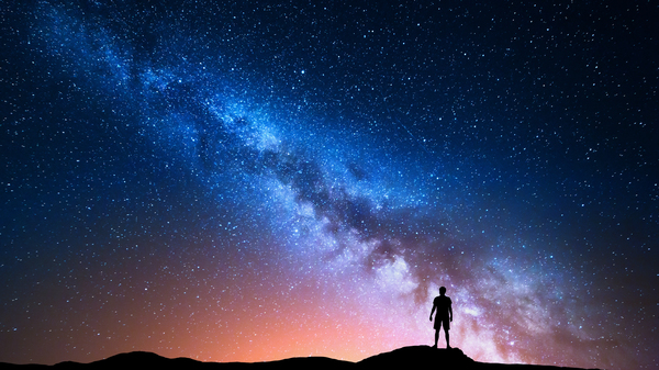 Man looking up at the Milky Way.