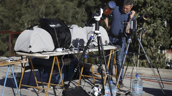 Telescopes set up to pint at the Sun to capture a total solar eclipse.