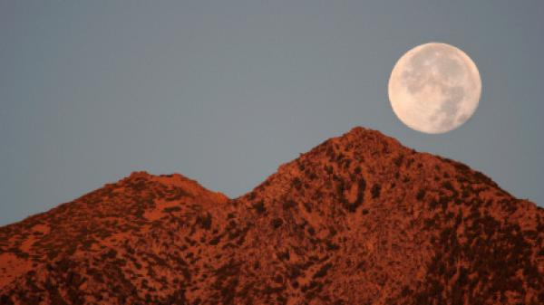 The Full Moon setting over Jobs Peak, Carson Valley, Nevada.