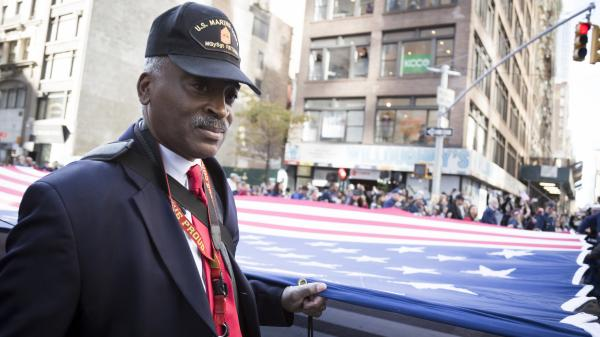 Vets and military personnel carry a large American flag in the annual parade up 5th Avenue on Veterans Day in Manhattan, New York.
