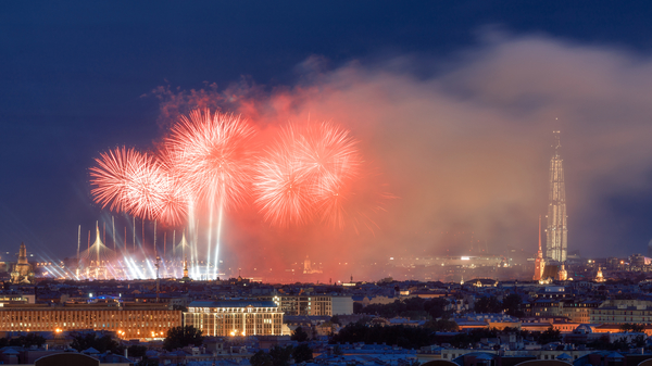 Fireworks explode above Saint Petersburg during the twilight of the Winter Nights Festival.