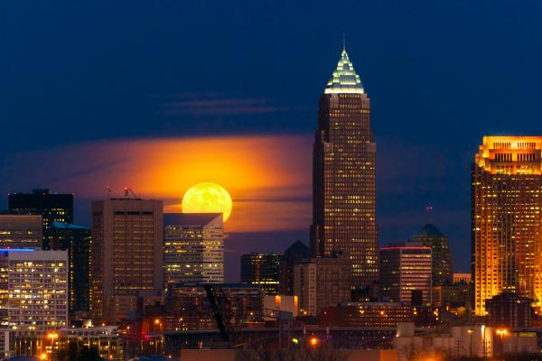 A Full Moon rising over the Cleveland skyline