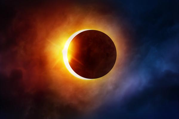 The solar disk about to become totally eclipsed by the Moon.