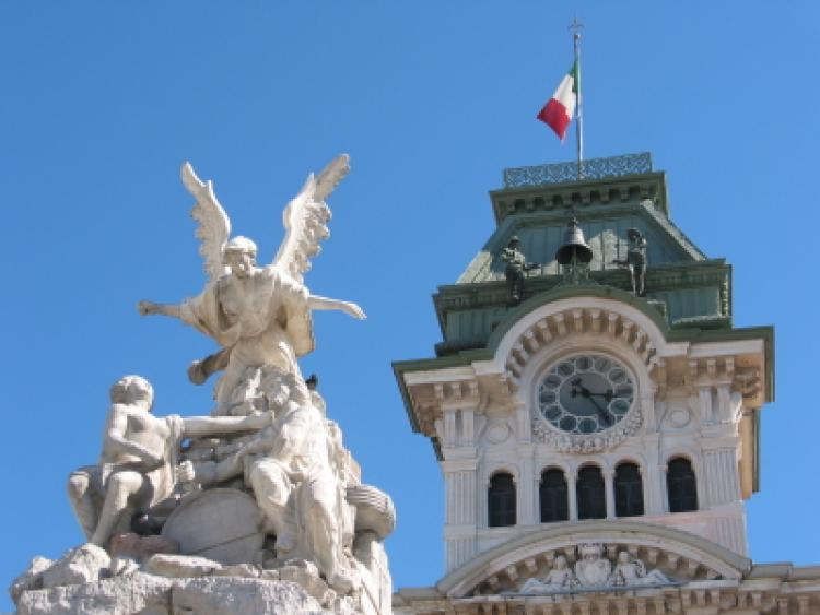 Fountain Sculpture and Town Hall with Clock. Trieste, Italy