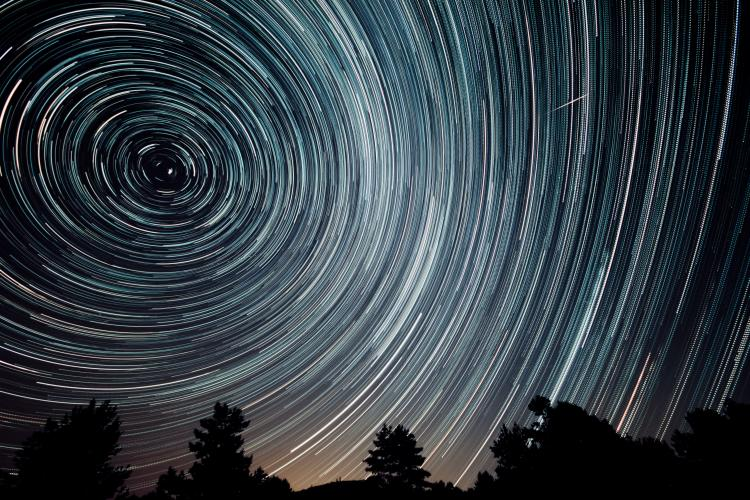 Dark sky at night with star trails.