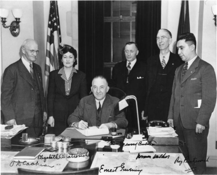 O.D. Cochran, Elizabeth Peratrovich, Edward Anderson, Norman Walker, and Roy Peratrovich at the signing of the Anti-Discrimination Act of 1945.