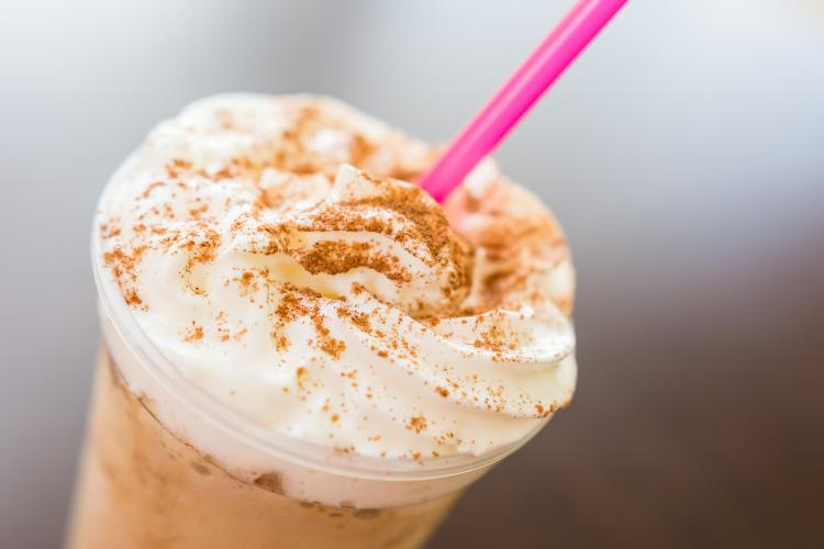 Ice and whipped cream frappe coffee with chocolate topping.
