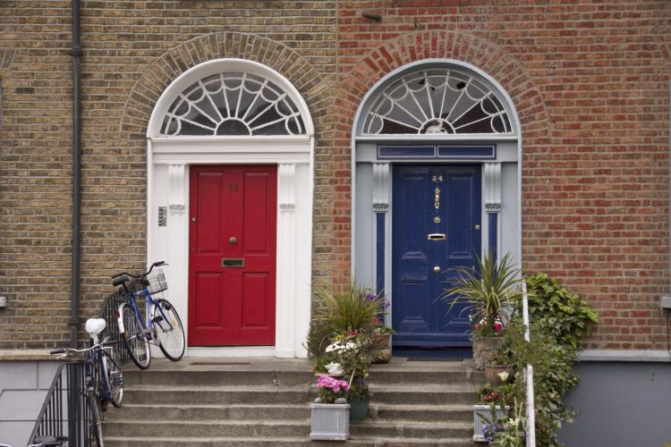 Red and blue neighbor doors in Dublin.