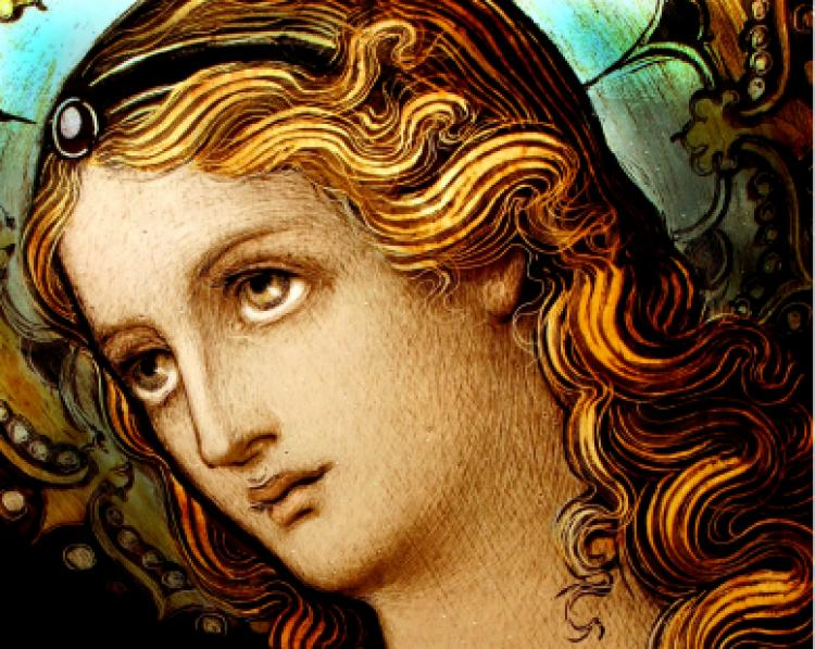 Detail shot of Mary from a stained glass window created in the late 1800's.
