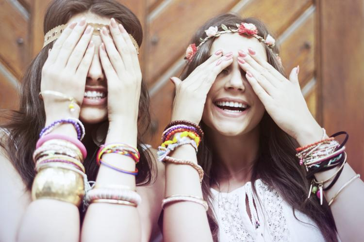Boho girls with arms full of bracelets.